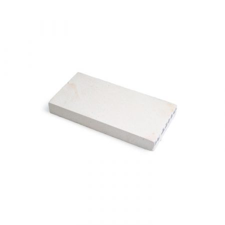 ladrillo refractario para soldar de color blanco.